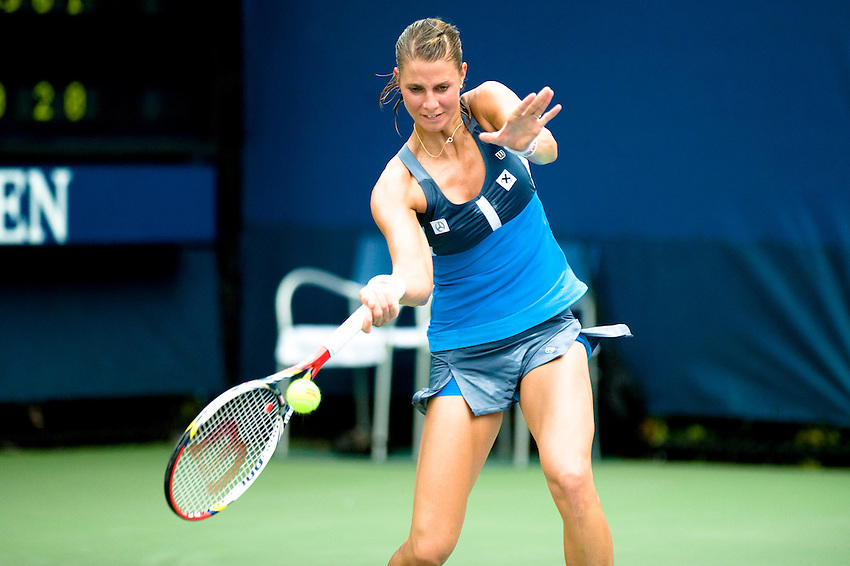 FLUSHING MEADOWS, NY - AUGUST 27: Mandy Minella competes in a first round match   of the US Open on August 27, 2012 at the USTA Billie Jean King National Tennis Center in New York. The US Open is the highest-attended annual sporting event in the world.