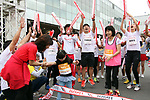 September 30, 2017, Tokyo, Japan - The last runner crosses the finish line of a family run at a charity run for the Special Olympics at Toyota's showroom Mega Web in Tokyo on Saturday, September 30, 2017. Some 1,800 people participated the charity event as Japan's Special Olympic Games will be held in Aichi in 2018.   (Photo by Yoshio Tsunoda/AFLO) LWX -ytd-