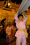 Donggang, Taiwan -- Young helper at Donglong Temple.