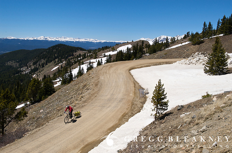 A touring cyclist descends Cottonwood Pass during a 7-day Rocky Mountain tour - Cottonwood Pass - Colorado
