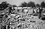 Shatila, the &quot;gipsy camp&quot; below the Sports city of Beirut. The dwellings are made of pieces of corrugated iron, scrap wood and sheets of plastic. Sometimes an old sofa is used to keep the improvised roofs in place, but most of the time old tires and stones are used as weights.<br />  <br /> Chatila, camp des &laquo;Nouri&eacute;&raquo; (Tsiganes) dans le &laquo;Hayy el Gharbi&raquo;, en contre-bas de la cit&eacute; sportive. Les habitations sont faits avec de la t&ocirc;le ondul&eacute;e, des bouts de bois et des b&acirc;ches en plastique. Parfois, c'est un vieux canap&eacute; qui maintient le toit improvis&eacute;, mais le plus souvent ce sont de vieux pneus ou des pierres qui font office de poids.