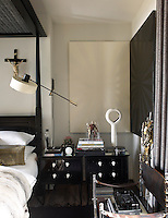The master bedroom has a black and white colour scheme reinforced by the pair of monochromes by Mustafa Hulusi in this corner of the room