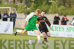 Kerry League midfielder Luke Burgess holds off the challenge of Cork Citys Billy Woods in their Eircom League Cup clash in Mounthawk Park on Monday evening..