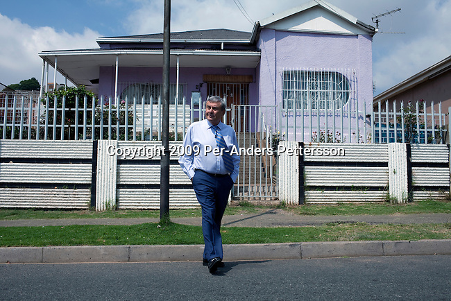 JOHANNESBURG, SOUTH AFRICA - APRIL 1: Sol Kerzner, the South African hotel magnate, walks on a street in his old neighborhood in Bez Valley on April 1, 2009 in Johannesburg, South Africa. Mr. Kerzner has finally returned to SA after spending many years overseas developing hotels. He opened a One&Only Hotel in Cape Town on April 3, 2009. His family owned the house in the background and the they lived there for a while. (Photo by Per-Anders Pettersson)