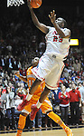 "Mississippi's Reginald Buckner (23) scores against Tennessee's Trae Golden (11)   at the C.M. ""Tad"" Smith Coliseum on Thursday, January 24, 2013. Mississippi won 62-56 to improve to 5-0 in the SEC. (AP Photo/Oxford Eagle, Bruce Newman)"