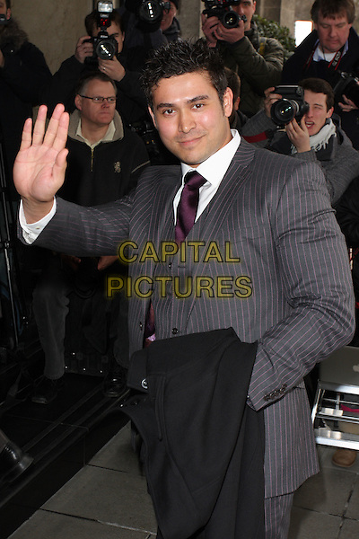 RAV WILDING .The TRIC Awards 2010 (Television and Radio Industries Club) held at the Grosvenor House Hotel, Park Lane, London, England..March 9th 2010.half length suit jacket grey gray hand palm waving .CAP/ROS.©Steve Ross/Capital Pictures.