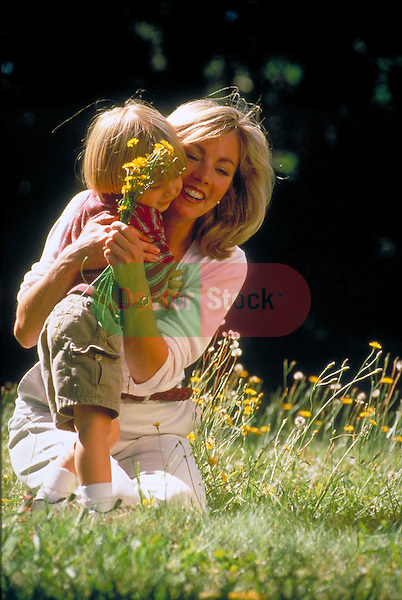 mother hugging young child outdoors