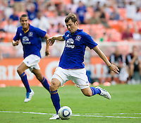 Diniyar Bilyaletdinov (7) of Everton shoots the ball for a goal during their friendly match held at RFK Stadium in Washington, DC.  D.C. United lost to Everton, 3-1.