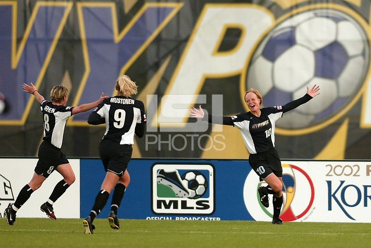 Anita Rapp of the New York Power celebrates a goal with teammates Linda Ormen and Minna Mustonen during their May 18th game with the Boston Breakers at Mitchel Athletic Complex. The Power lost 2-1.