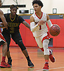Joshua Serrano #1 of Amityville, right, dribbles downcourt as Dionte Jordan #3 of Wyandanch guards him during a Suffolk County League VI varsity boys basketball game at Amityville High School on Tuesday, Jan. 2, 2018. Amityville won by a score of 95-50.