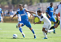 Geovanni (77) controls the ball against Juninho (19). The San Jose Earthquakes defeated the LA Galaxy 1-0 at Buck Shaw Stadium in Santa Clara, California on August 21st, 2010.