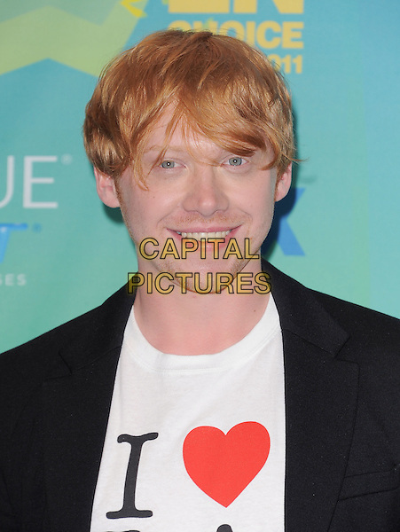 Rupert Grint .The Fox 2011 Teen Choice Awards held at Gibson Ampitheatre in Universal City, California, USA..August 7th, 2010.headshot portrait black jacket white t-shirt i heart love   .CAP/RKE/DVS.©DVS/RockinExposures/Capital Pictures.
