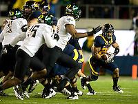 Isi Sofele of California runs the ball during the game against Oregon at Memorial Stadium in Berkeley, California on November 10th, 2012.   Oregon Ducks defeated California Bears, 59-17.
