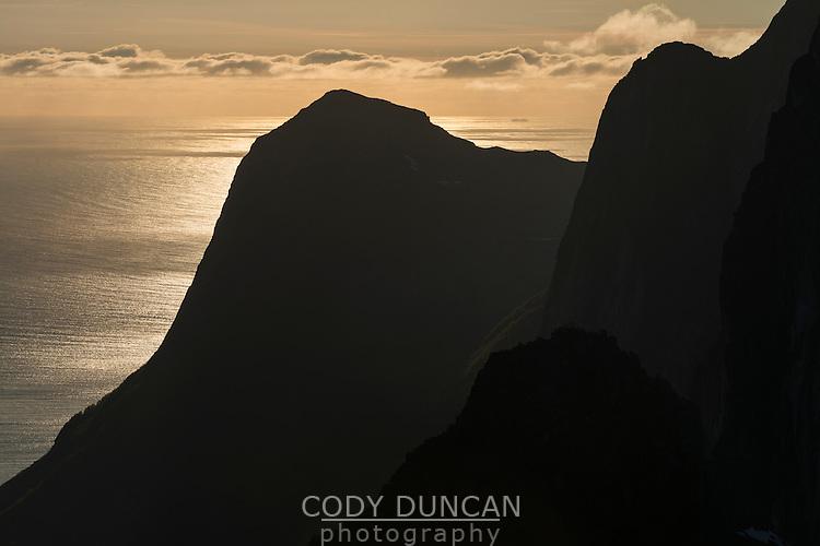 Silhouette of mountain peaks and sea, Senja, Norway
