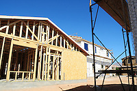 Phoenix, Arizona. November 17, 2012 - The Department of Commerce report on new housing building hints the market begins to strengthen. An increase of 15% in September in comparison to August to an adjusted annual rate of 872,000 units, shows new construction is up 34.8% from last year's. The U.S. housing market begins to strengthen as the Department of Commerce reports an increase of 15% in September in comparison to August to an adjusted annual rate of 872,000 units. From last year's numbers, new construction is up 34.8%. Photo by Eduardo Barraza © 2012