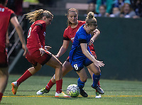 Seattle, WA - Saturday, May 14, 2016: Seattle Reign FC midfielder Kim Little (8) tries to dribble between Portland Thorns FC midfielders Allie Long (10) and Lindsey Horan (7) during the second half. The Portland Thorns FC and the Seattle Reign FC played to a 1-1 tie during a regular season National Women's Soccer League (NWSL) match at Memorial Stadium.