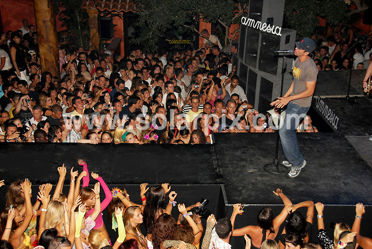 **ALL ROUND PICTURES FROM SOLARPIX.COM**.SYNDICATION RIGHTS FOR UK, CANADA, USA, SOUTH AFRICA, SOUTH AMERICA, DUBAI, AUSTRALIA, NEW ZEALAND, GREECE, ASIA.Enrique Iglesias, appearance  at Amnesia  Disco in Ibiza to promote his latest album Insomniac..JOB REF:4398-SPA     DATE:28_07_07.**MUST CREDIT SOLARPIX.COM OR DOUBLE FEE WILL BE CHARGED* *UNDER NO CIRCUMSTANCES IS THIS IMAGE TO BE REPRODUCED FOR ANY ONLINE EDITION WITHOUT PRIOR PERMISSION*