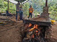 NWA Democrat-Gazette/J.T. WAMPLER Archie L. Reed of Cane Hill(right) cooks sorghum in a copper pan over a wood fire Sunday Sept. 20, 2015 at the 29th Annual Cane Hill Harvest Festival. Reed is visiting with Jonathon Smith, (left) and Allison Williams both of Fayetteville. The annual event also features demonstrations on making lye soap, live music, the Cane Hill College museum, arts & crafts vendors, quilt show and raffle, country store, food vendors, and more.
