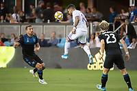 SAN JOSE,  - AUGUST 31: Guram Kashia #37 of the San Jose Earthquakes and Dom Dwyer  #14 of the Orlando City SC during a game between Orlando City SC and San Jose Earthquakes at Avaya Stadium on September 1, 2019 in San Jose, .