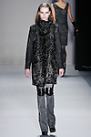 Gwen Loos walks the runway in a Nicole Miller Fall 2011 outfit, during Mercedes-Benz Fashion Week.