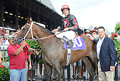 Manhattan Miss wins the fifth race at Saratoga on Aug. 26, 2009 for trainer Steve Klesaris and jockey Ramon Dominguez.