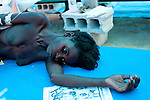 A woman who gave her name as Fizimis is treated for cholera at a clinic on Friday, November 26, 2010 in Cabaret, Haiti.