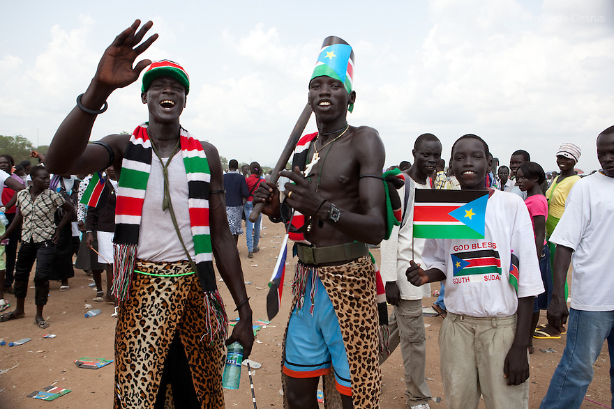 Saturday 9 july 2011 - Juba, Republic of South Sudan - South Sudanese boys wave the flag of their new country and dance during South Sudan's independence day celebrations in Juba. Tens of thousands of citizens of the new South Sudan celebrate national independence but whether statehood will resolve issues of identity after a decades-long war remains to be seen. Photo credit: Benedicte Desrus