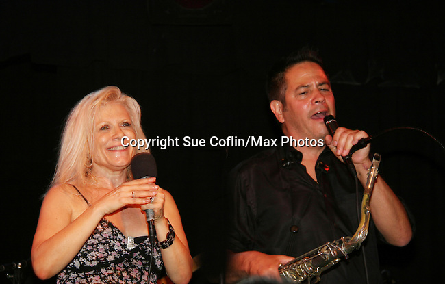 """One Life To Live's Ilene Kristen """"Roxy"""" performs with the saxaphonist during her show on her birthday, July 30, 2009 at The Triad, New York City, New York before actors, friends, fans and family. (Photo by Sue Coflin/Max Photos)"""
