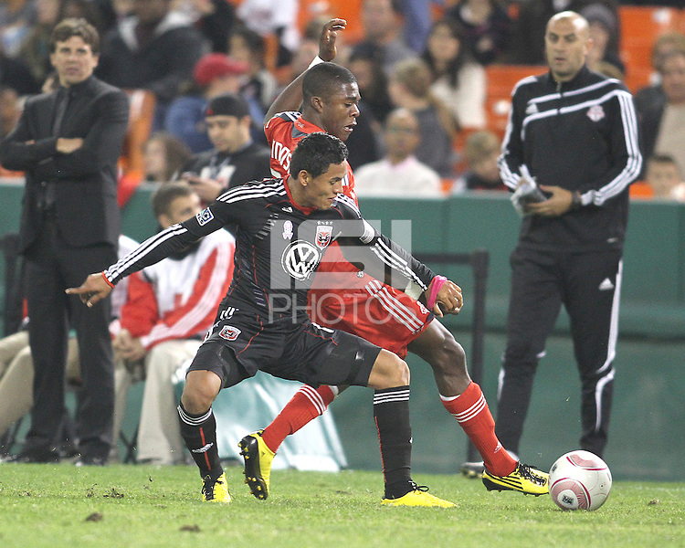 Andy Najar #14 of D.C. United battles for the ball with Nicholas Lindsay #37 of Toronto FC during an MLS match that was the final appearance of D.C. United's Jaime Moreno at RFK Stadium, in Washington D.C. on October 23, 2010. Toronto won 3-2.