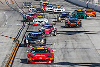 Olivier Beretta, #61 Ferrari 458 GT3 Italia, leads at the start of the Pirelli World challenge race, Long Beach Grand Prix, Long Beach, CA, April 2015.  (Photo by Brian Cleary/ www.bcpix.com )