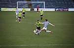 Action from the second-half as Greenock Morton (in hoops) defend against Stranraer in a Scottish League One match at Cappielow Park, Greenock. The match was between the top two teams in Scotland's third tier, with Morton winning by two goals to nil. The attendance was 1,921, above average for Morton's games during the 2014-15 season so far.