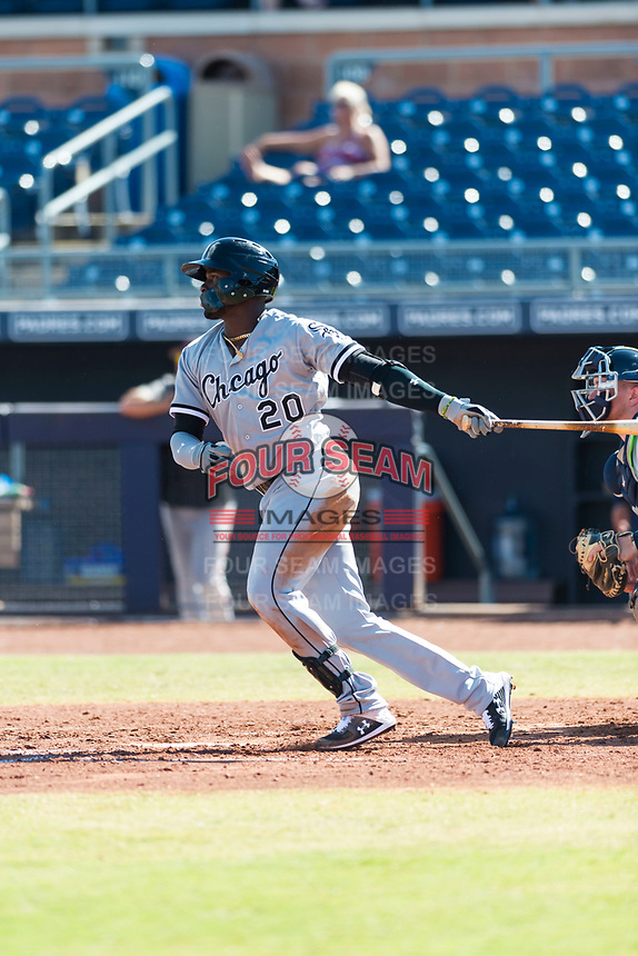 Glendale Desert Dogs designated hitter Luis Robert (20), of the Chicago White Sox organization, follows through on his swing during an Arizona Fall League game against the Peoria Javelinas at Peoria Sports Complex on October 22, 2018 in Peoria, Arizona. Glendale defeated Peoria 6-2. (Zachary Lucy/Four Seam Images)