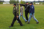06/01/11--Tualatin Police, Oregon State Police and biologist from the Oregon Department of Fish and Wildlife walks towards the direction of a black bear behind Tualatin Elementary School....Photo by Jaime Valdez..........................................