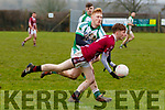 Brendan Foley, Cromane, gets his pass away despite the attentions of Brian Griffin, Ballybrown, during their sides clash in the Munster Junior B Club Football Final in Knockaderry