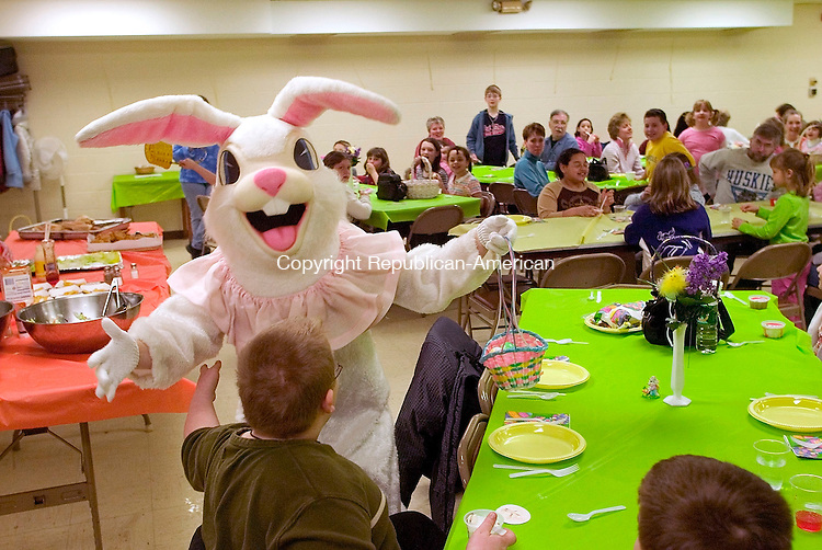 TORRINGTON, CT- 26 MARCH 2005-032605J02--Daniel Martin, 10, of Torrington, gets a hug from the Easter bunny on Saturday during the annual lunch and Easter egg hunt at the Center Congregational Church in Torrington. The event is sponsored by the Center Congregational Church's Christian Education Team--- Jim Shannon Photo--Daniel Martin; Torrington; Easter bunny, Center Congregational Churchare CQ