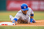 15 June 2016: Chicago Cubs shortstop Addison Russell dives safely back to first during game action against the Washington Nationals at Nationals Park in Washington, DC. The Cubs fell to the Nationals 5-4 in 12 innings, giving up the rubber match of their 3-game series. Mandatory Credit: Ed Wolfstein Photo *** RAW (NEF) Image File Available ***