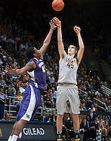 David Kravish of California shoots the ball during the game against Washington at Haas Pavilion in Berkeley, California on January 15th 2014.  California defeated Washington, 82-56.