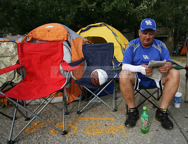 UK fan Mike Brumfield from Lexington reads the paper outside Memorial Coliseum during Big Blue Madness campout in Lexington, Ky., on Wednesday, October 2, 2013. Photo by Michael Reaves   Staff