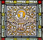 Nineteenth century Victorian stained glass eagle symbol of Saint John, Bishops Cannings church, Wiltshire, England, UK