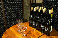 Bottle samples of various Beaucastel wines and three empty wine glasses. Chateau de Beaucastel, Domaines Perrin, Courthézon Courthezon Vaucluse France Europe