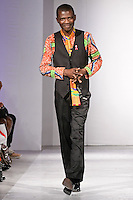 Ghanaian fashion designer Felix Anaman, walks the runway at the close of his Felix Anaman Clothing collection, during BK Fashion Weekend Spring Summer 2012.