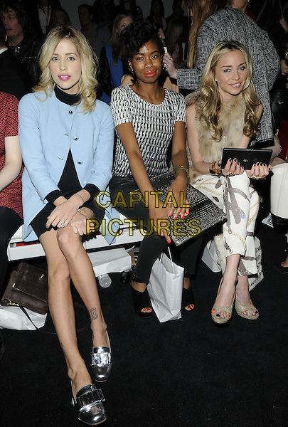 Peaches Geldof, Tolula Adeyemi & Noelle Reno.at PPQ London Fashion Week Autumn/Winter a/w show 2013, LFW day 1, BFC Showspace, Somerset House, The Strand, London, England..15th February 2013.London Fashion full length black dress pale blue coat jacket silver shoes sitting pregnant clutch bag pattern trousers beige fur.CAP/CAN.©Can Nguyen/Capital Pictures