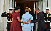United States President Barack Obama (R) and Michelle Obama escort President-elect Donald Trump and wife Melania into the White House for tea before the inauguration on January 20, 2017 in Washington, D.C.  Trump becomes the 45th President of the United States.      <br /> Credit: Kevin Dietsch / Pool via CNP