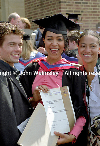 Very pleased new graduate shows off her certificate, Graduation Celebrations at Guildford Cathedral.