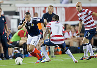 May 26, 2012:  Scotland Matt Phillips (7) tries to control the ball while being defended by USA Men's National Team m Maurice Edu (7) during action between the USA and Scotland at EverBank Field in Jacksonville, Florida.  USA defeated Scotland 5-1.............
