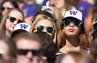 Husky students watch the action.