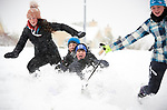 Matthew Mc Grath and Jack Joyce are propelled downhill in the snow by Aine Donegan and Maria Montwill at Woodstock View in Ennis. Photograph by John Kelly.