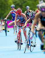 04 AUG 2012 - LONDON, GBR - Paula Findlay (CAN) of Canada (#55, in red, grey and white) exits transition for the start of the bike during the women's London 2012 Olympic Games Triathlon in Hyde Park, London, Great Britain (PHOTO (C) 2012 NIGEL FARROW)