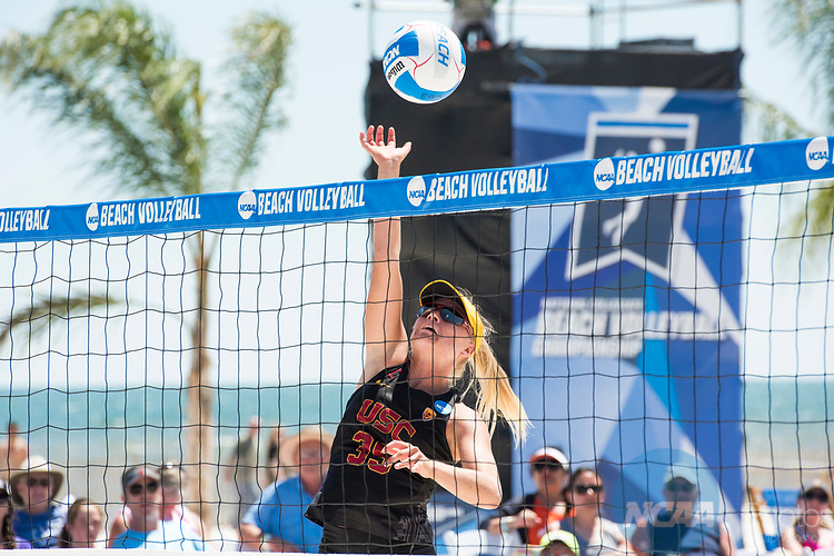 GULF SHORES, AL - MAY 07:  Nicolette Martin (35) of the University of Southern California hits the ball during the Division I Women's Beach Volleyball Championship held at Gulf Place on May 7, 2017 in Gulf Shores, Alabama.The University of Southern California defeated Pepperdine 3-2 to claim the national championship. (Photo by Stephen Nowland/NCAA Photos via Getty Images)