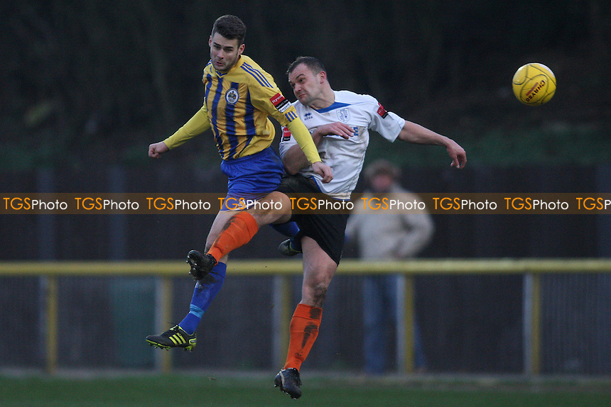 Paul Clayton of Romford heads clear - Romford vs Ware - Ryman League Division One North Football at Ship Lane, Thurrock FC - 12/01/13 - MANDATORY CREDIT: George Phillipou/TGSPHOTO - Self billing applies where appropriate - 0845 094 6026 - contact@tgsphoto.co.uk - NO UNPAID USE.